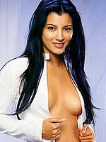 Kelly Hu posing sexy and without bra