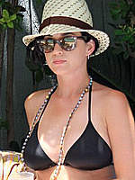 Katy Perry wearing a black bikini at pool