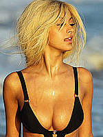 Zahia Dehar deep cleavage in black bikini