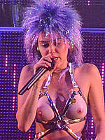 Miley Cyrus with fake nude tits and strap on