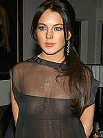 Lindsay Lohan no bra under transparent dress