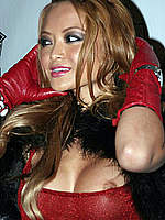 Tila Tequila flashing a nipple at the party