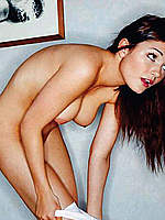 Busty India Reynolds posing naked for mags
