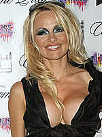 Pamela Anderson deep cleavage at fashion show